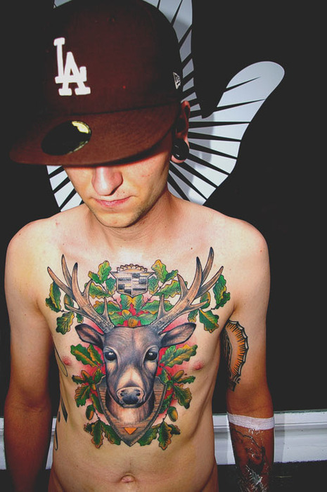 deer head on chest tattoo